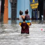 The Filipino Spirit is reassuring! Shown in this pic is a man with two kids on his shoulders crossing a flooded Roosevelt Avenue in Quezon City on Tuesday. via GMA NEWS [https://www.facebook.com/gmanews]